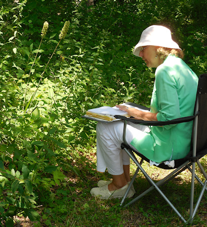 Lori studying a plant species
